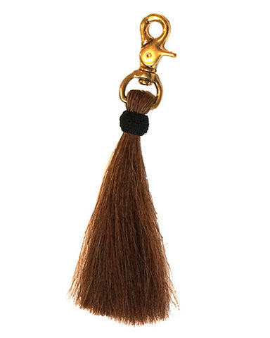brown horse hair tassel on brass clip