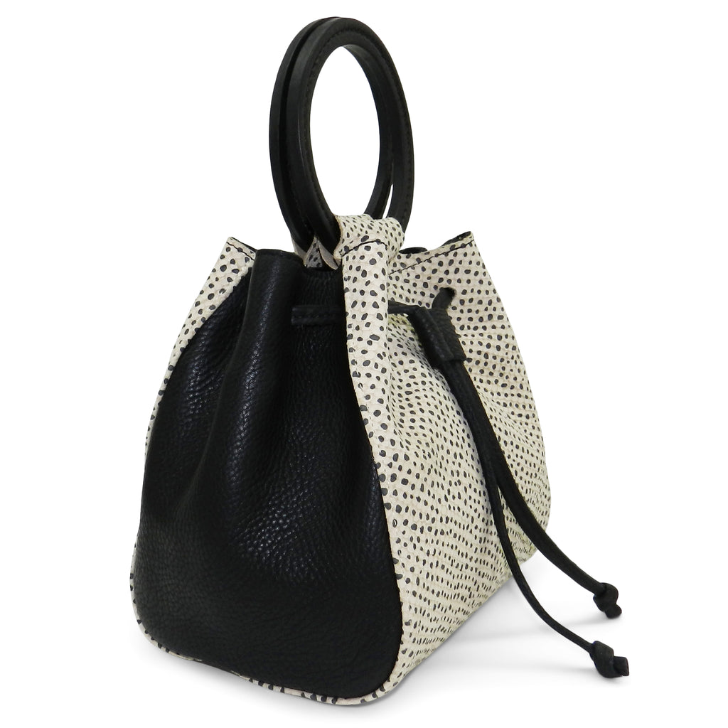 carmella drawstring in tan with black dot snake & black pebble leather