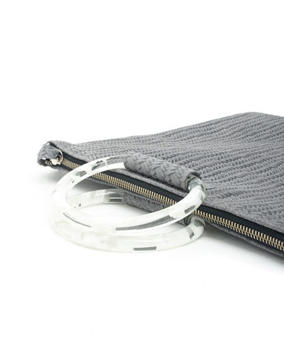 jolie clutch with clear handles in grey woven leather