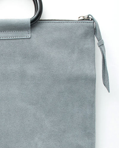 jolie clutch with black handles in grey suede leather