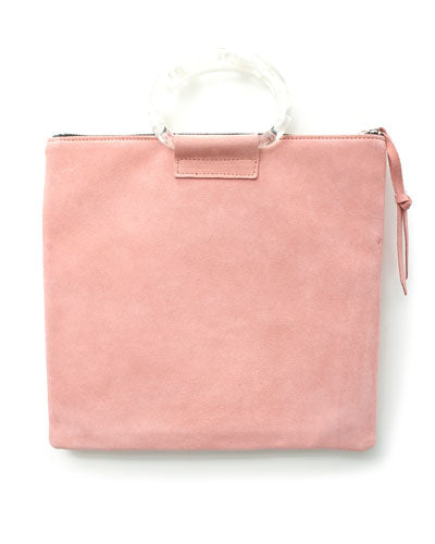 jolie clutch with clear handles in pink suede leather