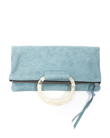 jolie clutch with white handles in ocean pearlized leather