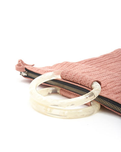 jolie clutch with clear handles in pink woven leather