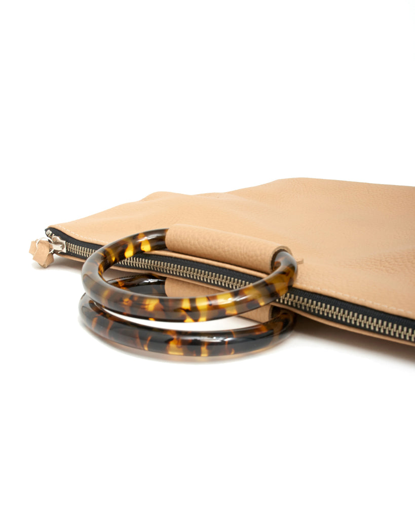 jolie clutch with tortoise handles in oatmeal buffalo leather