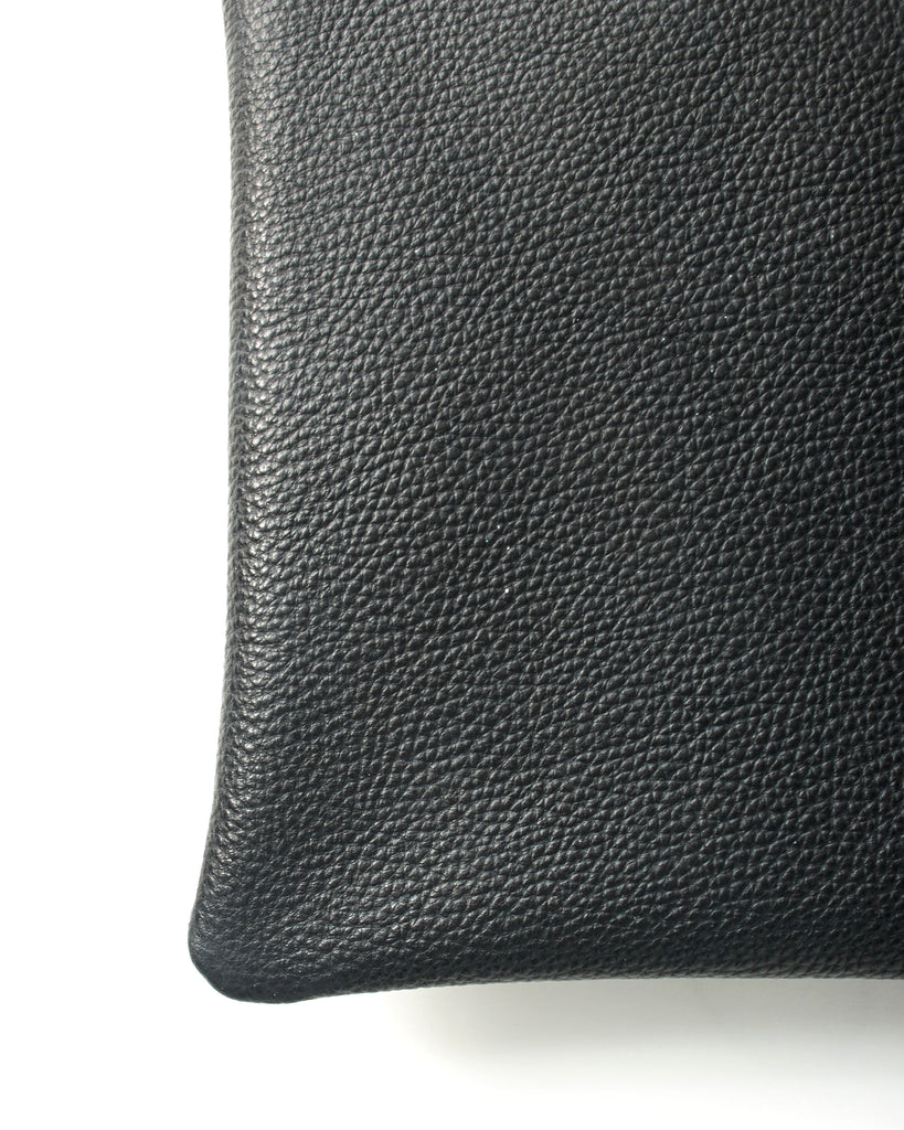 jolie clutch with tortoise handles in black buffalo leather