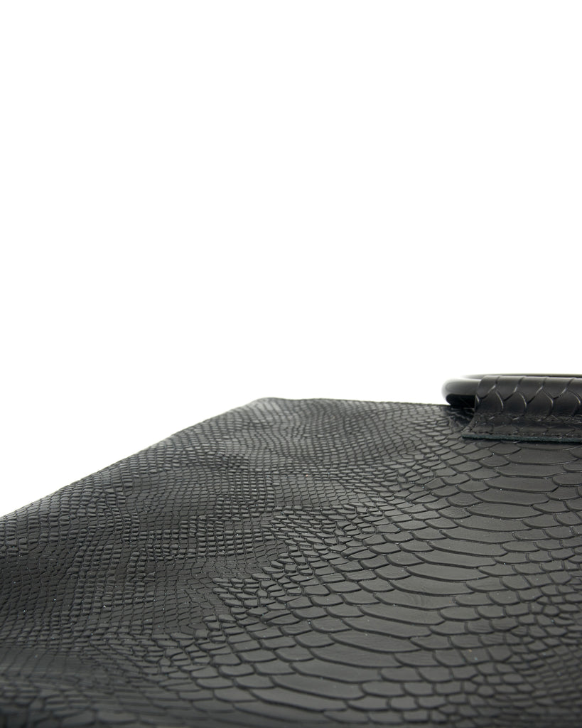 jolie clutch with black handles in black snake leather