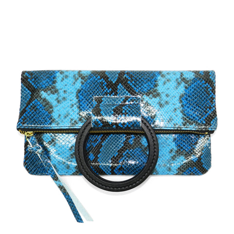 jolie clutch with handmade leather handles in blue python leather