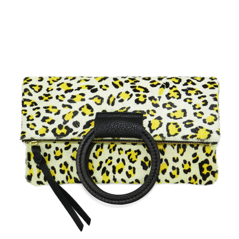 jolie clutch with handmade leather handles in citron leopard haircalf