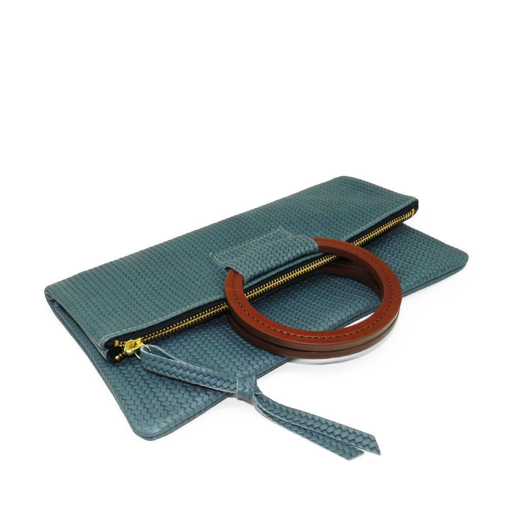 jolie clutch with handmade leather handles in ocean woven leather