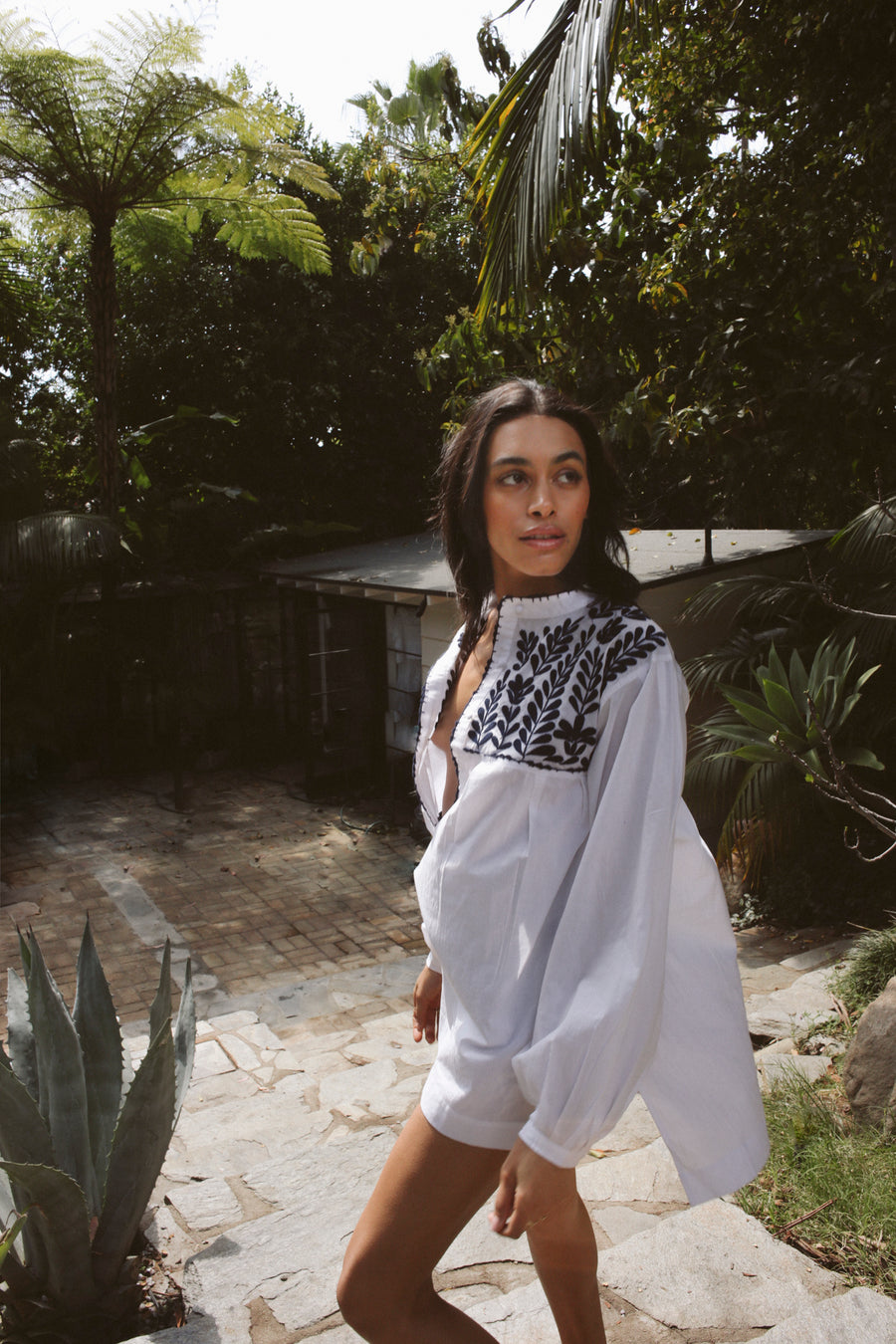 100% pima cotton, easy fitting tunic/coverup in white with pleated voluminous sleeves and blue indigo petal embroidery at the front and back yoke.