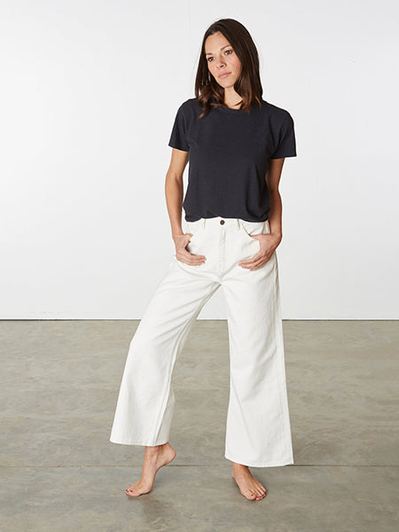 The Ariel Wide Leg Jeans in an undyed natural cream shade made from 100% GOTS certified organic cotton. Nickel free-silver button and zip at front to fasten. Made fair-trade.
