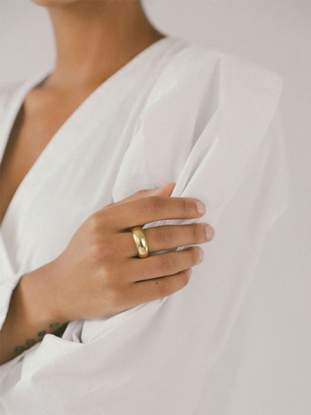 The thick statement ring is made from 14k gold plated bronze. Made with recycled metals. Handmade in Canada.