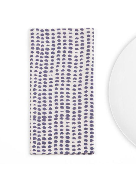 A textural play of hand-printed dots against a white background makes this napkin an especially easy addition to any tabletop.