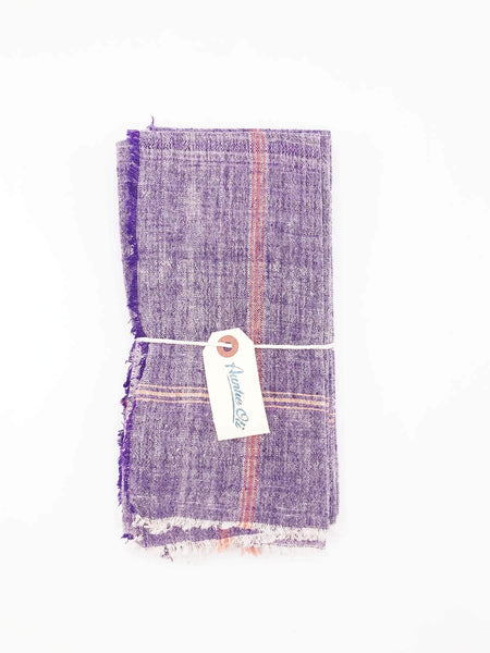 "Cheery purple napkin set made from 100% cotton khadi. Khadi is a fabric woven by hand of hand-spun yarn. Set of 6. Napkins measure 20""X20"""