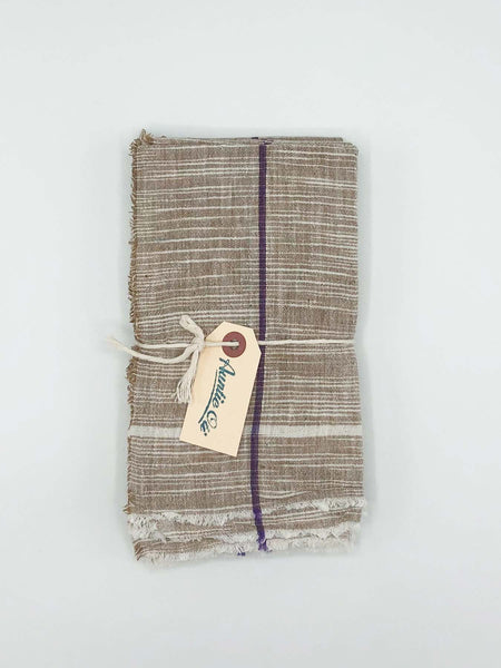 "Cheery brown napkin set made from 100% cotton khadi. Khadi is a fabric woven by hand of hand-spun yarn. Set of 6. Napkins measure 18″ X 18""."
