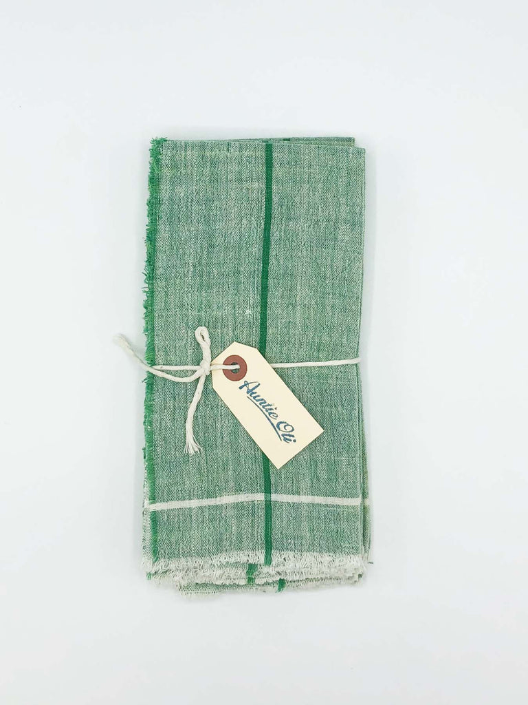 "Cheery green napkin set made from 100% cotton khadi. Khadi is a fabric woven by hand of hand-spun yarn. Set of 6. Napkins measure 18″ X 18""."