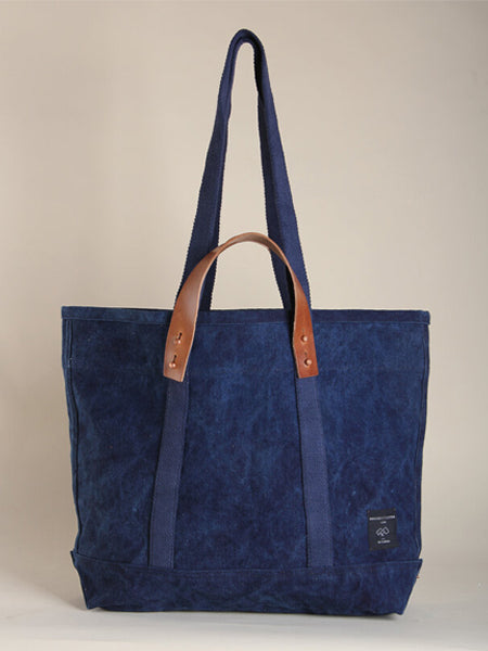 A large tote with one interior pocket. Perfectly oversized to use at the market or beach. Detachable leather handles mean they convert from hand-held to shoulder bag, Indigo is dyed by hand using natural indigo dye, a time-staking and laborious process of love.