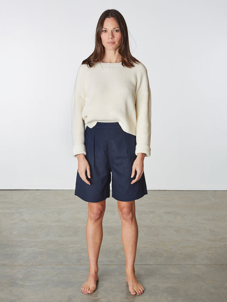 Raw silk high-rise shorts with front welt pockets, front pleats, back darts and side zip closure with button. Length hits just above knees. 100% raw silk. Hand wash.