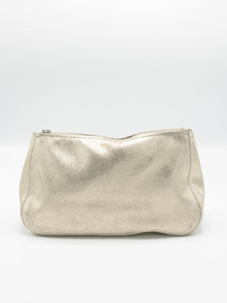 "The Fatty is a hallmark of the Tracey Tanner collection. We love in this ""sparkle"" champagne leather. Use as a clutch or a cosmetic bag. Measures 7.5""-8.5""W x 5""H x 3""D. Made in Brooklyn."