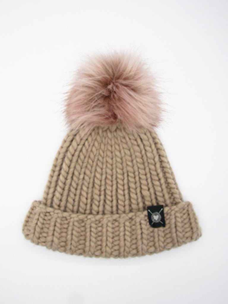 "This class beanie shape is hand knit in 100% merino wool Faux fur pom topper. Fits average size teen to adult woman's head (22""). Fiber content: 100% extra fine merino wool."