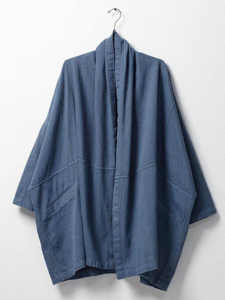 Oversized Jacket with 2 front Pockets. It is made from an upcycled denim.  Recycled Cotton. Made in USA