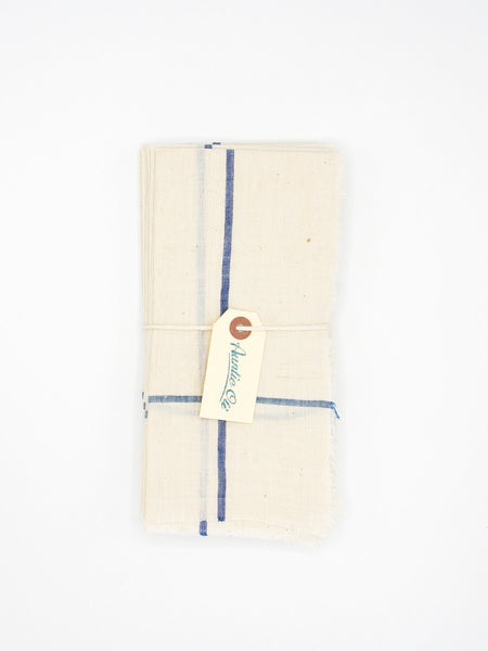 "Cheery white napkin set made from 100% cotton khadi. Khadi is a fabric woven by hand of hand-spun yarn. Set of 6. Napkins measure 18″ X 18""."