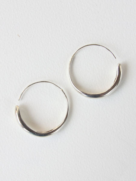 "Gradient hoops that are thin at the ear wire and gradually widen. Measure 1.5"" in diameter. Sterling silver. Handmade."