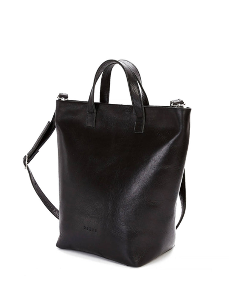An elegant, practical tote bag with with top handles and removable, cross body leather strap. Vegetable tanned smooth leather. Lined with striped fabric. Features one interior pocket and zipper closure.