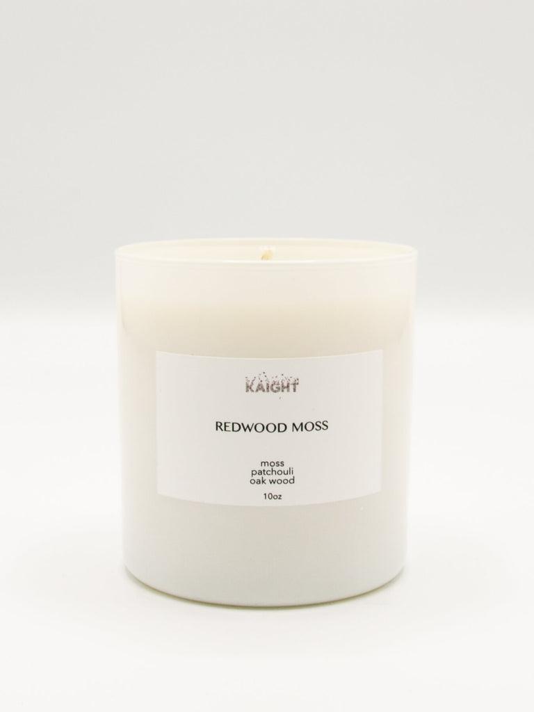 Our Redwood Moss Candle has top notes of Fern and Moss; middle notes of Cedar Wood and Pine and base notes of Firewood and Oak Moss for a fragrant woodsy scent. 100% soy wax with natural cotton wick. Hand poured in Brooklyn. 10 oz. with approx. 60 hour burn time. Packaged in a beautiful white box that makes these ideal for gifting.
