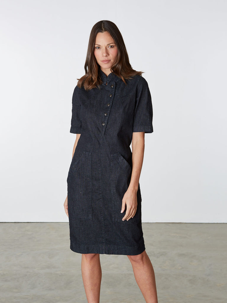 Back by popular demand, this versatile denim dress intended to wear all year round. Our recent favorite is a militant, short sleeve uniform with a flipped-up button front lapel and center back zip. Large task pockets on the front and a vented back hem for getting down to business. 79% cotton 20% polyester 1% spandex. Made in Seattle, U.S.A.