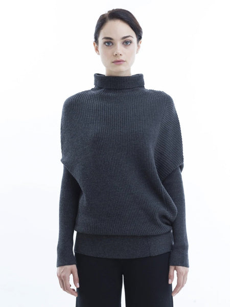 This is my all time favorite sweater! Unique rib play at left side panel, creating an unexpected lightweight, soft warmth. Oversized fit with fitted sleeves.