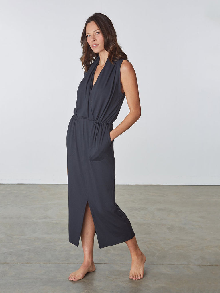 This sleeveless dress features an elegant draped neckline and slim silhouette. Made from ultra soft rayon jersey. Machine wash cold. Made in USA.