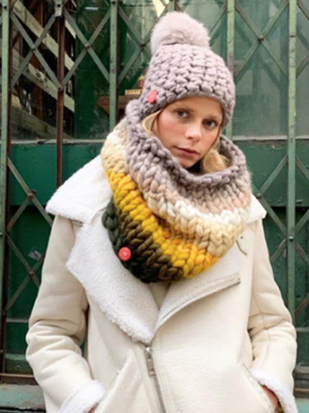 Inject a dose of color and warmth into your winter uniform with this merino wool snood. Wear it around the neck as a scarf/collar, pull it over your head like a hood or wear down around your shoulders. Hand knit from handspun, ultra-soft handdyed, ethically sourced merino wool. Made in NYC.