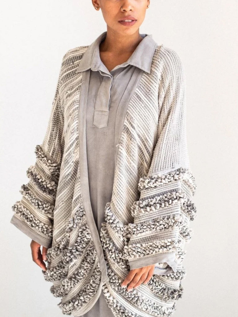 This draped jacket features a unique texture made by a pile weave technique with small scraps of remnant fabric. The grey colorway is naturally dyed to pair beautifully with natural tones. Free size. Ethically made.