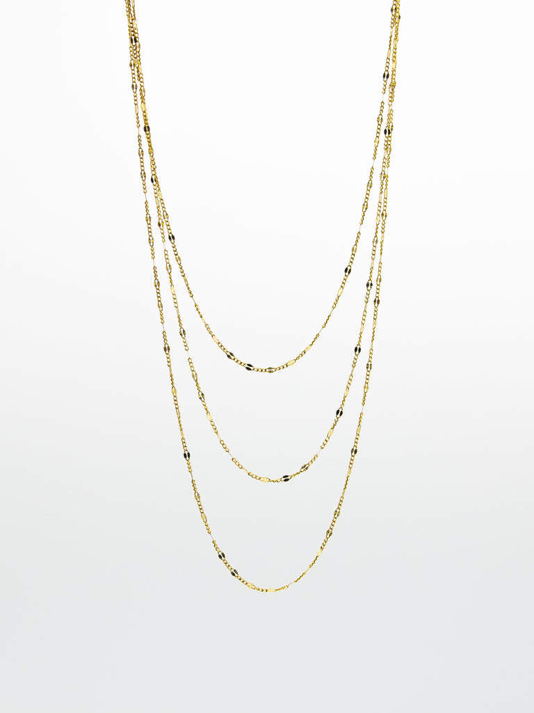 "Elegant layering chains in 14k gold. 16"", 18"", and 20"" lengths available. Delicate and ornate, Gjenmi's Tagging Choker is both lightweight and eye-catching. Modern and timeless pieces for everyday wear."