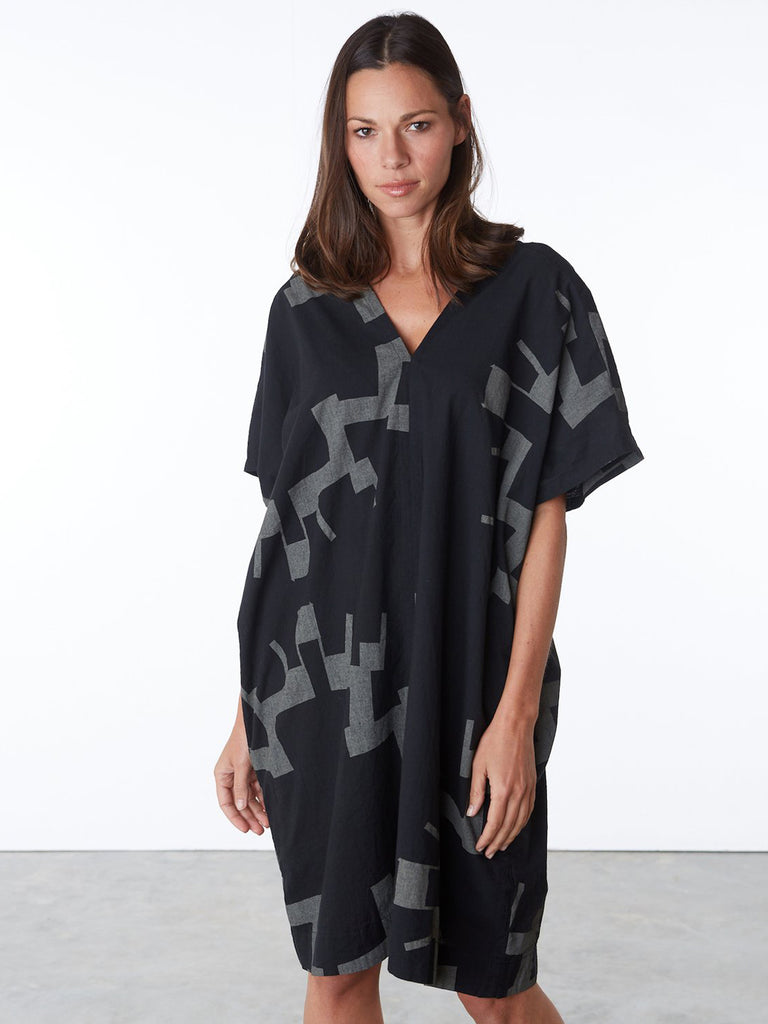The classic UZI oversized short sleeve v-neck cotton dress in a bold new print. Features side pockets. Wear this style all year long. Layer it over tights or leggings now and loose and breezy in spring/summer.