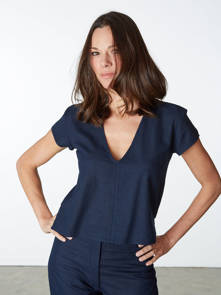 Raw silk v-neck top with cap-sleeves, small side slits and center front seam detail. Back hem is slightly longer than front. Made with love in a Fair Trade Certified™ facility in India.