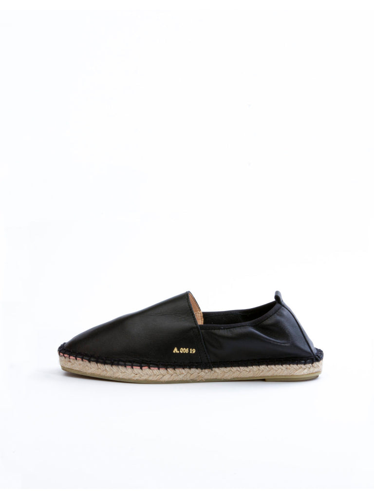 Classic slip-on either espadrilles. Slips on. Features a leather lining and a padded insole for extraordinary softness and comfort. Made by hand in Spain with only the best quality fabrics and leathers.