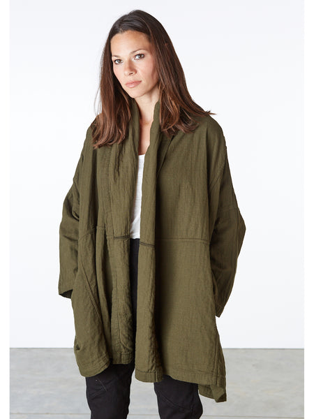 Atelier Delphine's Signature piece, the Haori Coat has a loose, oversized poncho-style silhouette. Features a open, shawl collar and 2 welt pockets at the side. 100% Japanese cotton. Machine washable. Made in USA