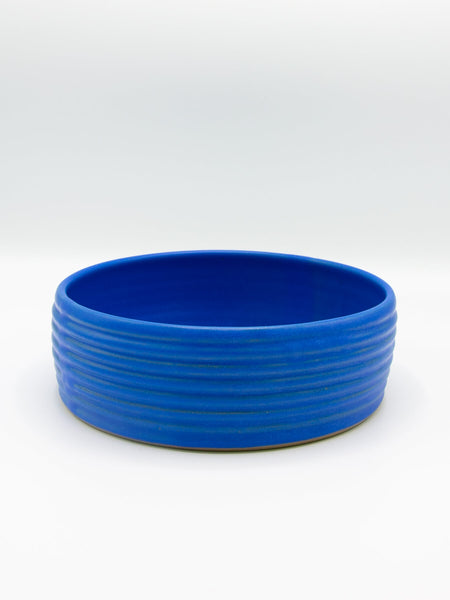 A beautiful side serving bowl to dress up and dinner party. Made from hardy stoneware. Side walls are textured while throwing so each on is slightly different than the next. More of a flat bottom straighter wall bowl, good for sides and small casseroles. Dishwasher safe, Microwave and oven safe