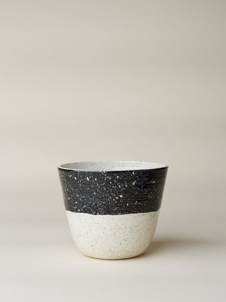 "Porcelain planter thrown on the wheel and hand painted with speckled pattern. Measures approximately 6"" tall and 7"" wide. Handmade in LA."