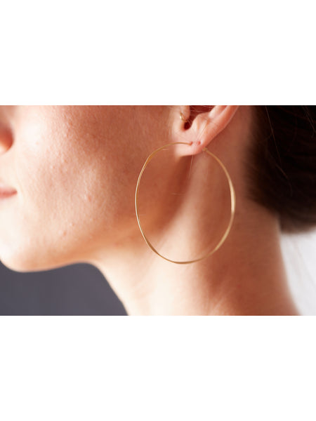 These classic hammered hoops are the perfect statement-making pair to add to a modern, casual collection. The thin gold-fill hoops feature an organic, hammered texture and quality craftsmanship. 14k gold fill