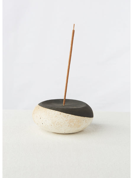 "Create a sanctuary in your home with this beautiful hand built stoneware incense burner with hand painted constellations. Measures approximately 5"" x 2"","