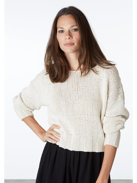 An airy, loose knit sweater with puff sleeves. 100% cotton yarn. Made in Barcelona.