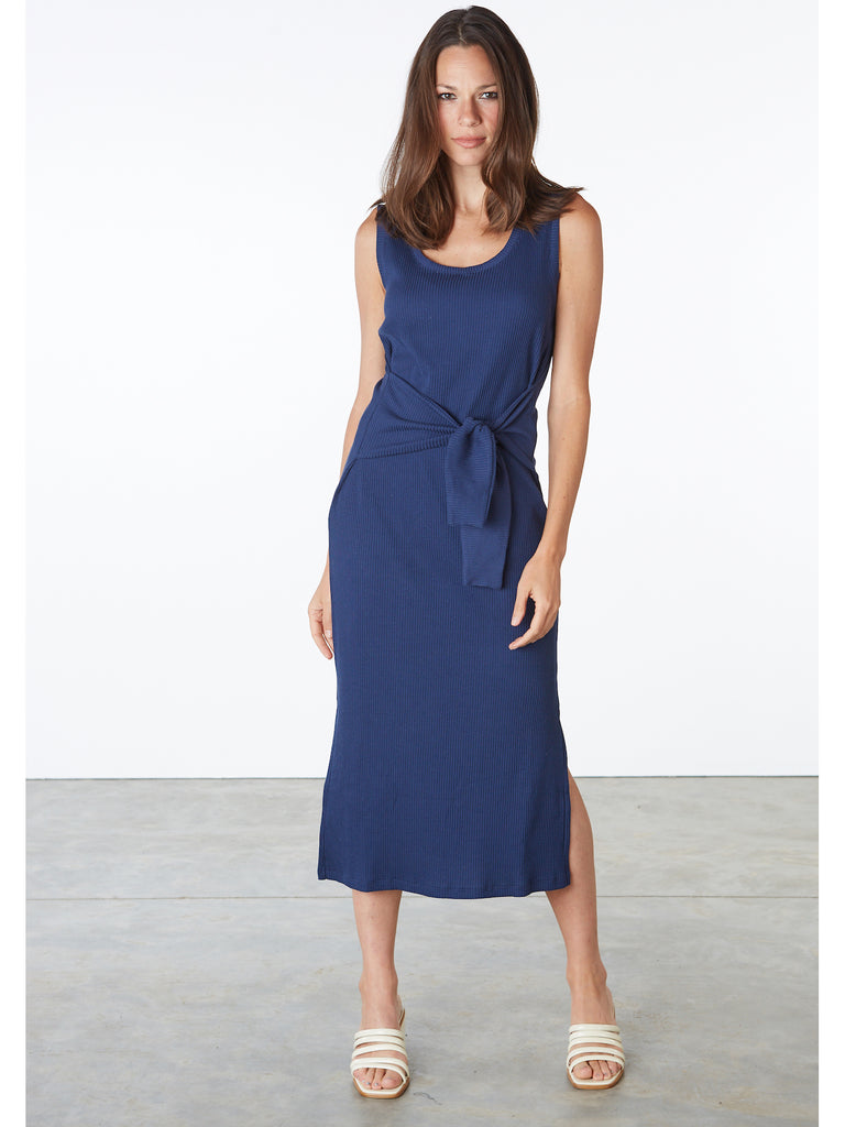 Long Ribbed Dress, sleeveless, with front tie.  Since its creation, Rita Row has set very clear goals: to create garments with an elegant and comfortable functionality. Inspired by the image of a modern, hardworking woman.
