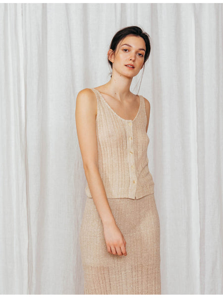 An elegant sleeveless top that buttons down the front and features a slight v-neck. Sleeveless and breezy, perfect for the summer. Slightly sheer. 60% Linen / 40% Viscose.