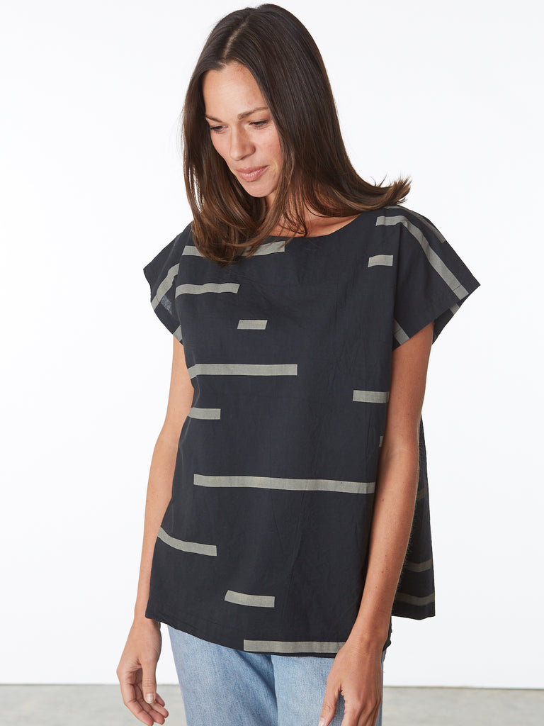 The Uzi Broken Stripe Tunic is back! Same great fit and shape. Oversize woven 100% cotton top with hand printed design. Boat neckline. Cap sleeves with dropped armhole. Slips on.