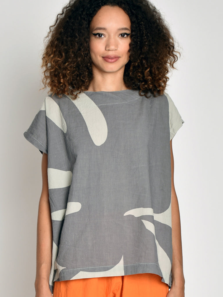 This beloved tunic style is back in a fresh new print. Same great fit and shape. Oversize woven 100% cotton top with hand printed design. Boat neckline. Cap sleeves with dropped armhole. Slips on. Machine wash. Printed with water based ink. Pre-washed. One size. Made in Brooklyn.