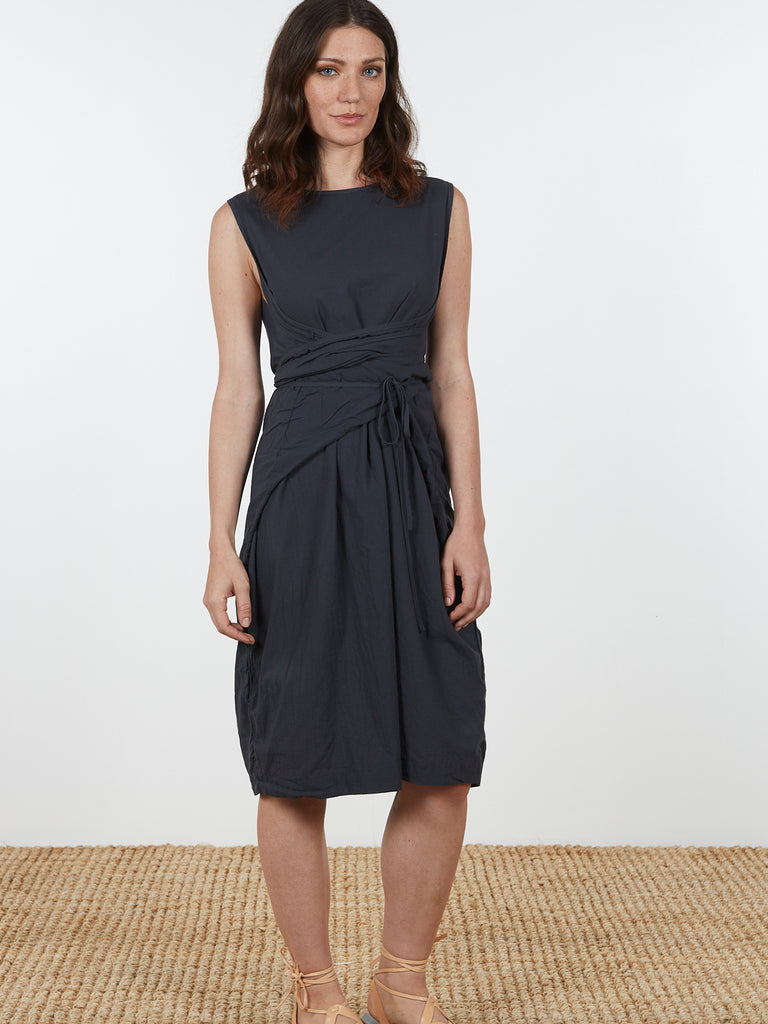 A loose fitting shift dress with adjustable ties that make this a 3-in-1 summer staple. Wear with ties tied at the back for a loose, a-line shape, or wrap the ties at the waist for an elegant, fitted silhouette