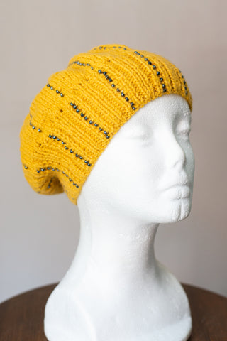 Knitted beanie in yellow with seed beads